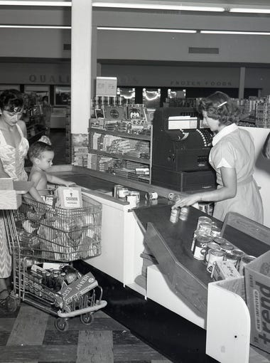 Customers check out at the Suburban MiniMax grocery store in Wynwood shopping center in August 1952.