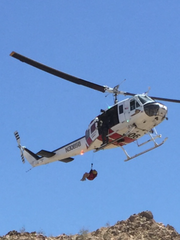 Mackenzie Cosgrove is hoisted into a helicopter after being bitten by a ratllesnake on Eisenhower Mountain on May 10, 2015.