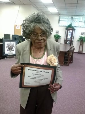 Mattie Mobley displays a longevity award bestowed to her by the National Hook-Up of Black Women, Inc., a national, nonprofit 501c3 organization that advocates for black women and their families.