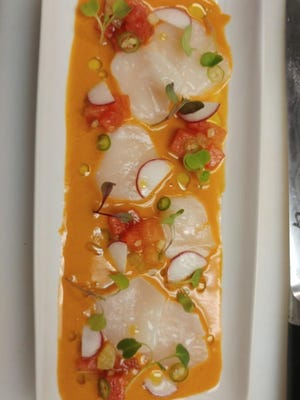 Heirloom tomato and watermelon gazpacho with scallops crudo by Chef Gregg McCarthy.