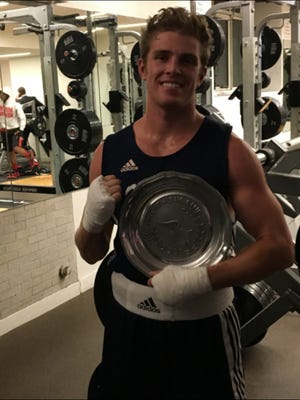 Nevada boxing club team senior boxer Zack Smith won by unanimous decision over Tafari Garvesande from Lock Haven on Monday.