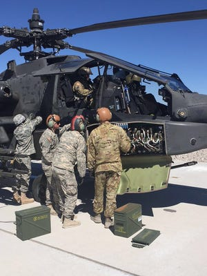 A fuel and armament team from 1-501st load up fuel, rockets and 30 mm rounds onto an Apache during aerial-gunnery training.