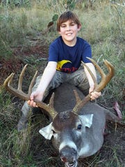 J. Curtis Cantwell, 11, killed this 10-point buck while hunting on the family ranch in Live Oak County.