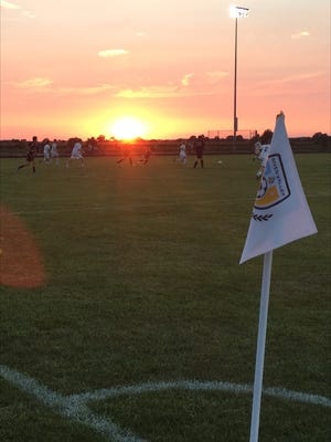 River Valley and Marion Harding play at sunset during the Futbol Friday Night boys soccer opener on Aug. 18.