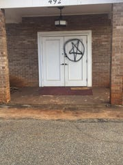 A pentagram was spray painted on the door of Joy Fellowship