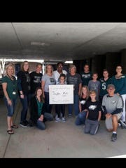 Teachers and students at Hancock Creek Elementary School dress in green for fifth-grade teacher Brandy Peterson. Son Jaylen Watkins is playing in the Super Bowl for the Philadelphia Eagles.