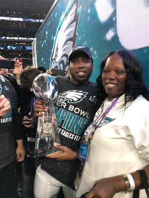 Jaylen Watkins and his mom, Brandy Peterson, celebrate on the field in Minneapolis after the Philadelphia Eagles won Super Bowl LII. Watkins signed a 1-year deal with the Los Angeles Chargers.