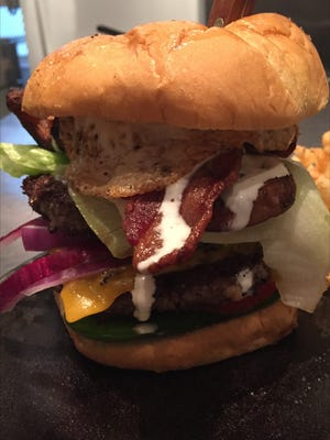 The Day After  Burger at Roots Restaurant Tavern features a full pound of beef.