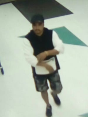 Police released this image of a man suspected in a purse snatching. Police said the purse snatching happened at about 3 a.m. on Friday, March 23 at the Pay-Less Supermarket at the Micronesia Mall in Dededo.