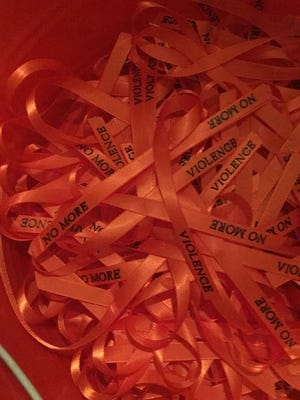Orange ribbons for Saturday's Stop the Violence event.