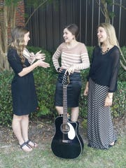 """Local high school students Whitney Robertson (left), Jordan McCorvey (middle) and Emily Gunter (left) have sung together for longer than they can remember. Last year, they officially called their group """"Moriya"""" and since have performed at school, churches, retreats, community events, Tamp & Grind Coffee Shop and at the statewide Youth Evangelism Conference at the Cajundome in Lafayette for about 7,000 people."""