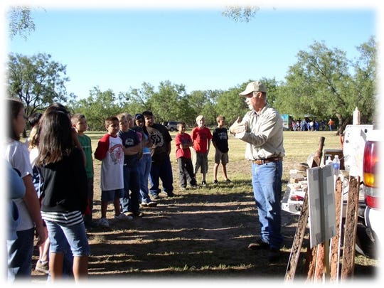 Rodney Flanagan speaks to students attending the annual outdoor classroom day event.