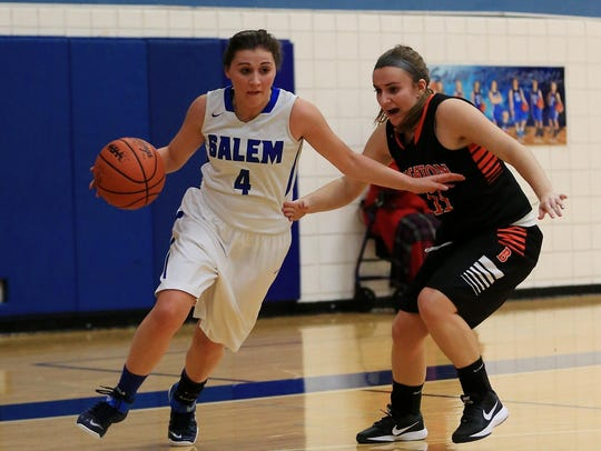 Salem's Marisa Martin dribbles past a Brighton player