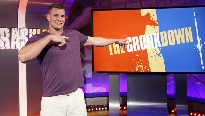 """In this March, 2016 photo provided by Nickelodeon, Rob Gronkowski hosts """"Crashletes,"""" in Los Angeles, debuting July 5, 2016 on Nickelodeon. The New England Patriots tight end will be the face of the show introducing popular viral videos of sports bloopers. (Nickelodeon via AP)"""