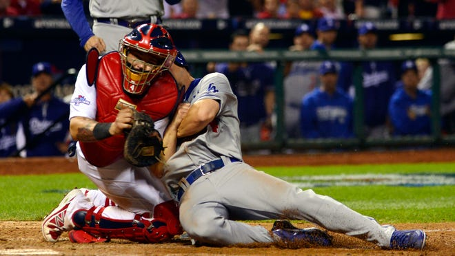 In Game 1 of the NLCS, Cardinals catcher Yadier Molina tagged — or so it seemed — Mark Ellis of the Dodgers. Replays were conclusive that their bodies collided, not so clear if the glove that held the ball made contact with Ellis.
