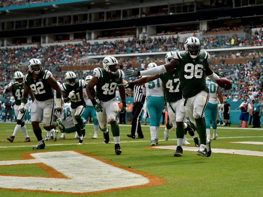 New York Jets defensive end Muhammad Wilkerson (96) celebrates after intercepts a pass during the first half against the Miami Dolphins at Hard Rock Stadium.