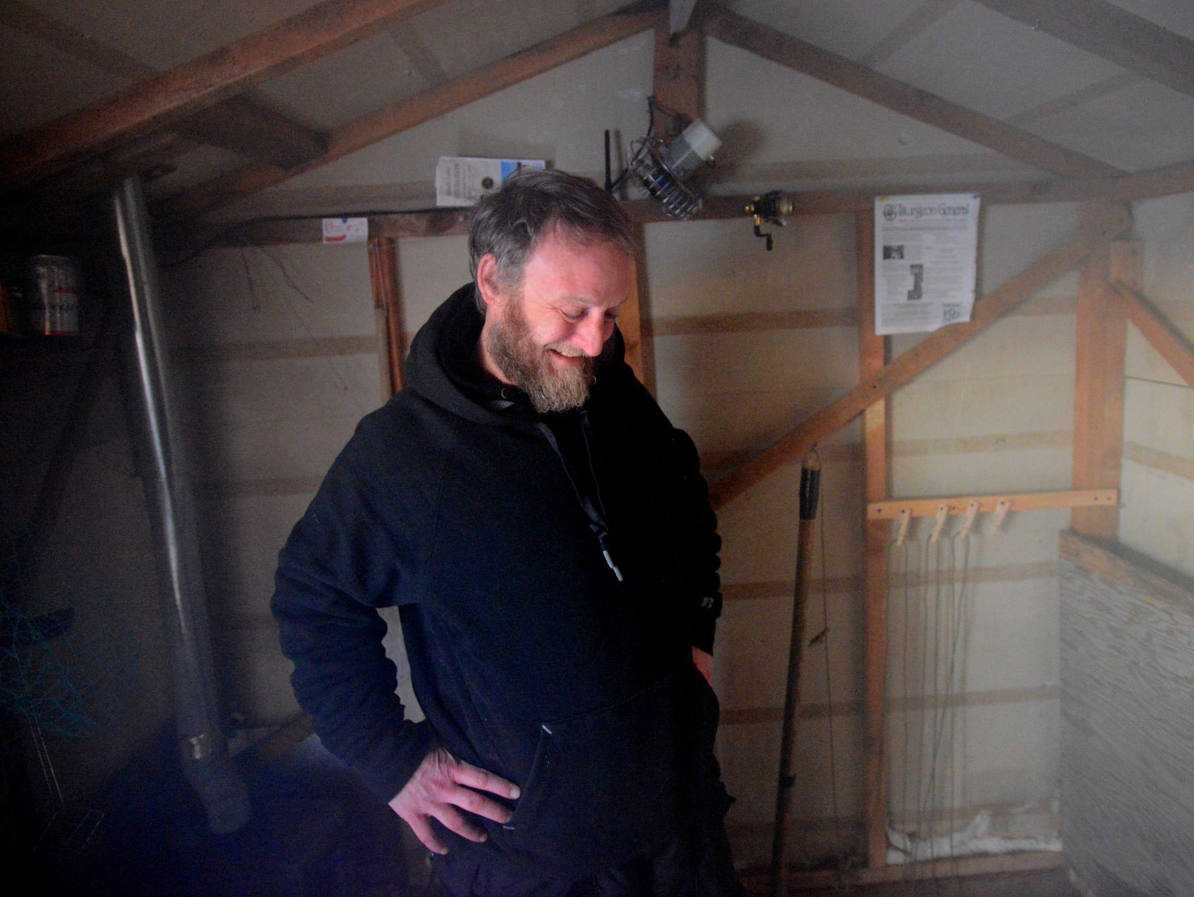 Last year's Sturgeon King Brian Bailey waits for sturgeon