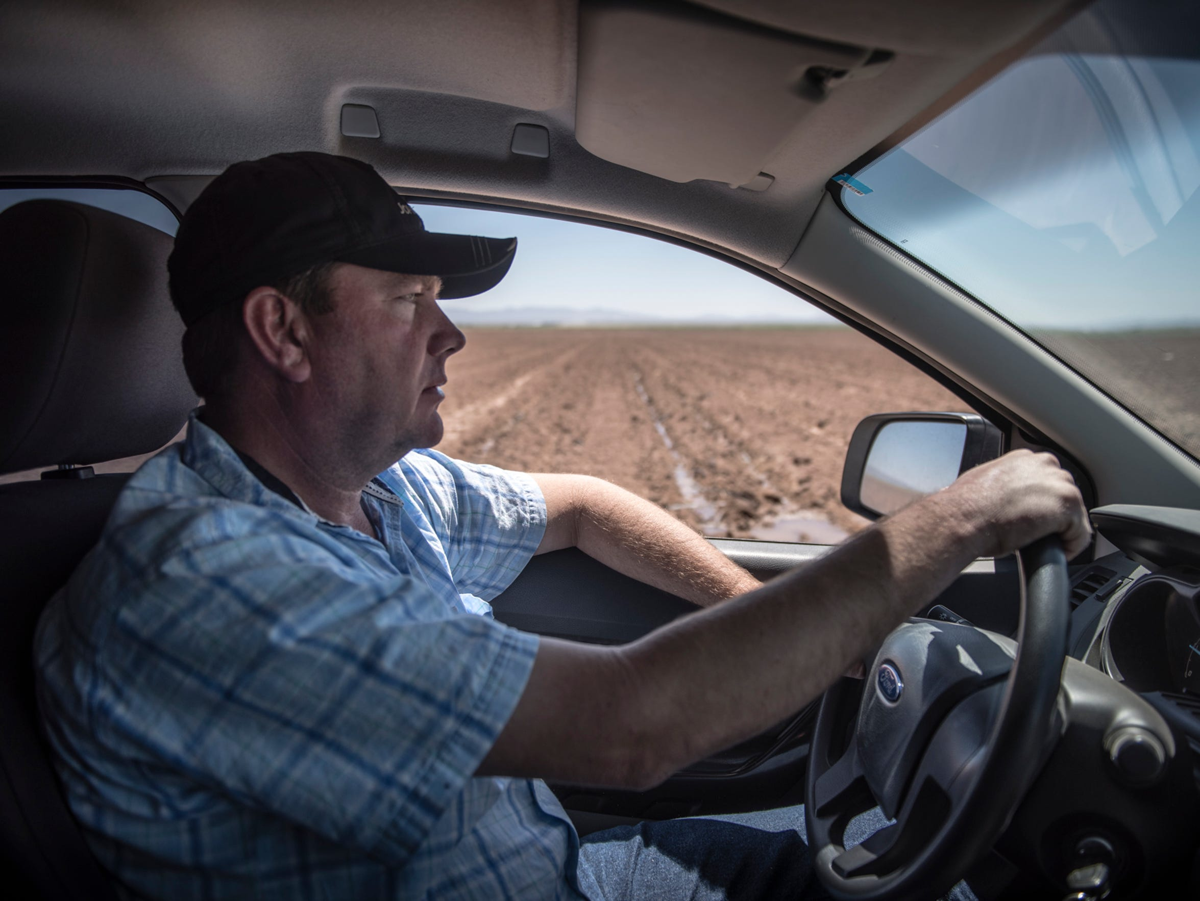 Mexican farmer Pedro Suderman drives his diesel truck