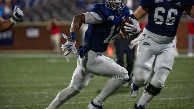 Georgia Southern's Wesley Kennedy III of Savannah scores a touchdown against the South Alabama Jaguars on Thursday night at Paulson Stadium in Statesboro.
