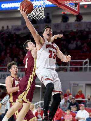 University of South Dakota's Tyler Flack goes up for a shot while Western Illinois' Jake Pemberton defends during their game at Sanford Coyote Sports Center in Vermillion on Saturday, Jan. 28, 2017.