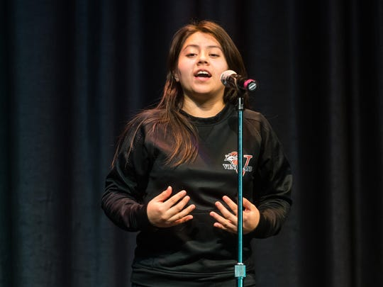 Marilyn Miguel recites 'I Am Learning to Abandon the World by Linda Pastan during the Poetry Out Loud Competition at Vineland High School on Tuesday, January 16.