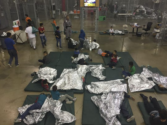 This U.S. Customs and Border Protection photo shows intake of illegal border crossers by U.S. Border Patrol agents at the Central Processing Center in McAllen, Texas, on May 23, 2018.