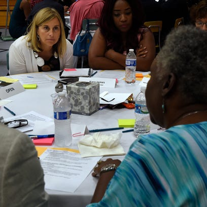 Mayor Megan Barry listens to members of some of the