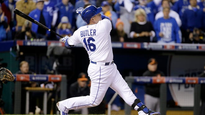 Kansas City Royals' Billy Butler watches his sacrifice fly during the sixth inning of Game 3 of the American League baseball championship series against the Baltimore Orioles Tuesday, Oct. 14, 2014, in Kansas City, Mo. Jarrod Dyson scored on the play. (AP Photo/Charlie Riedel)