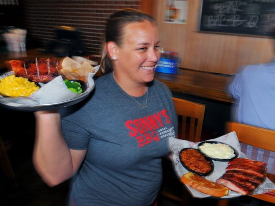 Sonny's BBQ is one of the Treasure Coast restaurants offering a day when Kids Eat Free when accompanied by  a paying adult.