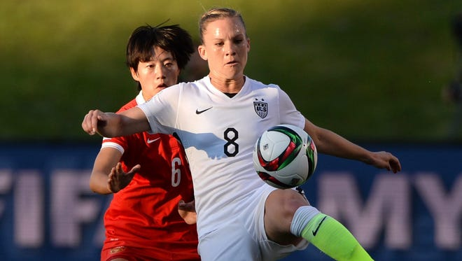 United States' Amy Rodriguez (8) controls the ball as China's Li Dongna (6) defends during the first half of a quarterfinal match in the FIFA Women's World Cup soccer tournament, Friday, June 26, 2015, in Ottawa, Ontario, Canada.