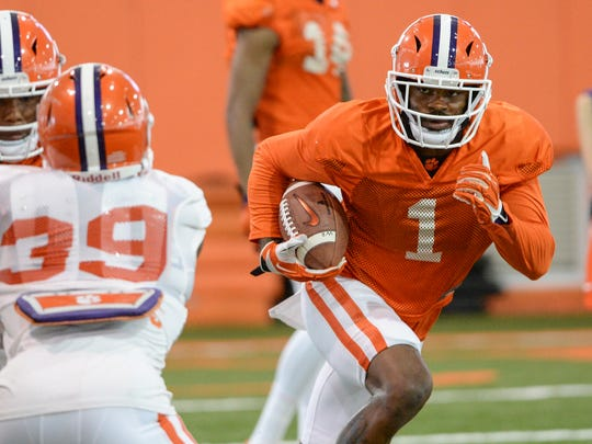Clemson wide receiver Trevion Thompson (1) runs after catching a ball during preseason football practice in Clemson on Tuesday.