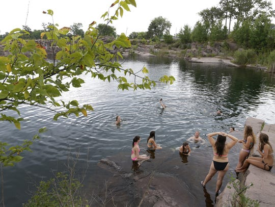 Young people gather at the Redgranite Quarry in August.