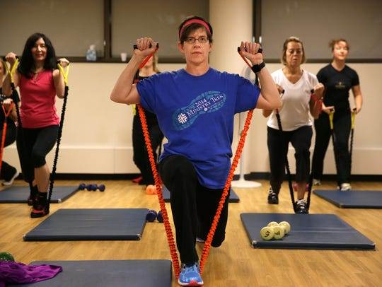 Sandy Campbell performs lunges during the Weight of