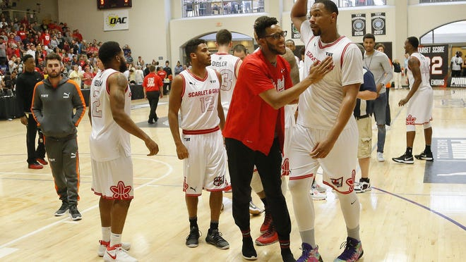 Scarlet & Gray assistant coach Evan Turner gives Jared Sullinger (0) a pat on the chest following during The Basketball Tournament second-round game against the Matadors at Capital University in 2018. Sullinger is now the coach for Carmen's Crew and Turner is the team' general manager.