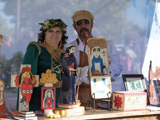 Gloria and Margarito Mondragon of Las Vegas, N.M., dress in period costumes to show Margarito's retablos and bultos at the new Artistas del Camino Real feature at the recent Renaissance ArtsFaire.