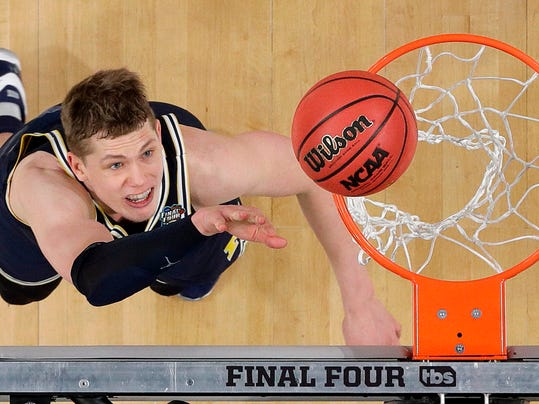 Michigan's Moritz Wagner (13) watches his shot during the second half in the championship game of the Final Four NCAA college basketball tournament against Villanova, Monday, April 2, 2018, in San Antonio. (AP Photo/David J. Phillip)