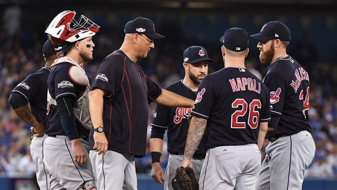Oct 17, 2016; Toronto, Ontario, CAN; Cleveland Indians manager Terry Francona (center) brings in relief pitcher Zach McAllister (far right) during the fourth inning in game three of the 2016 ALCS playoff baseball series against the Toronto Blue Jays at Rogers Centre. Mandatory Credit: Nick Turchiaro-USA TODAY Sports ORG XMIT: USATSI-347498 ORIG FILE ID:  20161017_ter_bt2_145.JPG