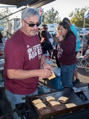 Robert Chavez, New Mexico State Lamda Chi Alpha alumni, mans the grill at a tailgate party before the NMSU Aggies homecoming football game Saturday afternoon outside Aggie Memorial Stadium on Oct. 28, 2017.