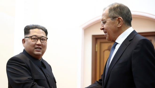 Korean leader Kim Jong Un, left, and Russia's Foreign Minister Sergei Lavrov shake hands during a meeting in Pyongyang, North Korea, Thursday, May 31, 2018 .