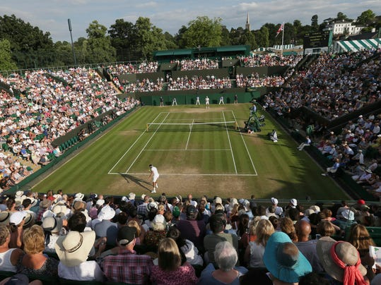 Jo—Wilfried Tsonga of France returns to Sam Querrey of the United States during their Men's Singles Match on day five at the Wimbledon Tennis Championships in London Friday, July 7, 2017. (AP Photo/Tim Ireland)