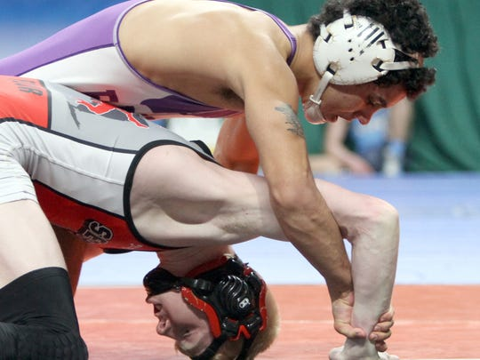 Elmira's Noah Carpenter tries to fend off Victor's Mike Venosa in their Division I 132-pound state quarterfinal at the Times Union Center in Albany.