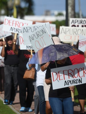 "In this Jan. 29 file photo, ""Defrock Apuron"" and ""Apuron"
