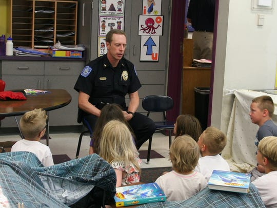 Norwalk Police Chief Greg Staples talks to Mrs. Dirks second grade classroom at Oviatt Elementary on their last day of school. The chief tries to visit with every classroom in the school  district at least once a year.