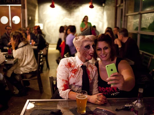 Natalie May and Robin Mattox of Port Huron take a photo together during last year's Zombie Crawl on Saturday, October 18, 2014 at Casey's in downtown Port Huron. JEFFREY M. SMITH/TIMES HERALD.