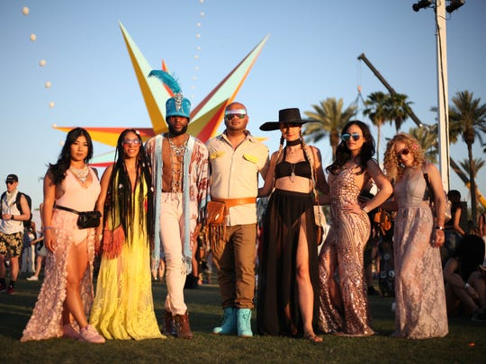 A group poses, wearing some of this year's trends at