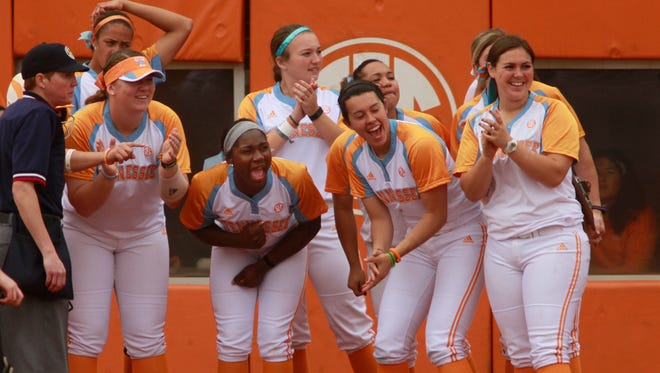 The Lady Vols team waits at home for Shaliyah Geathers after she hit a home run in the second inning of the SEC conference game March 22, 2015, at Lee Stadium in Knoxville.