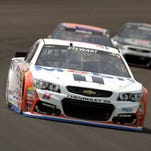 Tony Stewart drives through the first turn during the Brickyard 400.