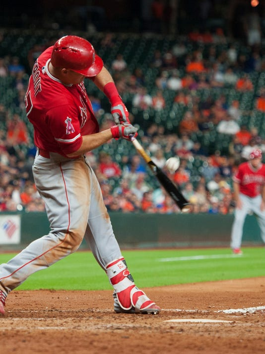 Los Angeles Angels center fielder Mike Trout (27) hits a triple against the Houston Astros during the sixth inning of a baseball game Tuesday, June 21, 2016, in Houston. (AP Photo/George Bridges)