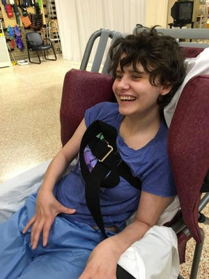 Sydni Briggs smiles at Lakeview Specialty Hospital and Rehab Center in Waterford, Wis. Briggs is severely brain damaged after a failed suicide attempt at a Wisconsin juvenile prison in 2015. The state agreed on March 20, 2018, to pay her $18.9 million.