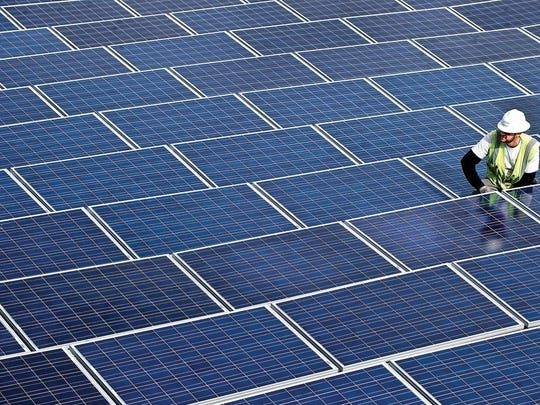 In this January 2011 photo, solar panels are placed on three roofs atop the Robert Hoag Rawlings Public Library in Pueblo, Colo. (John Jaques/The Pueblo Chieftain via AP)